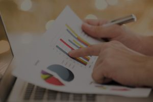 Business owner reviewing financial information and business valuation graphs